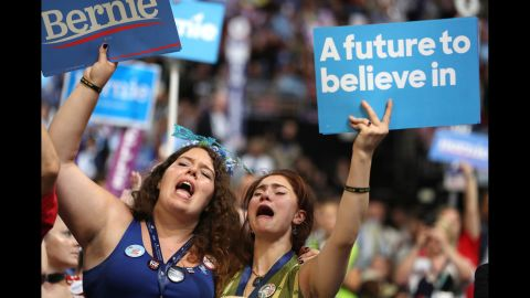 Supporters of Sen. Bernie Sanders (I-VT) stand and cheer as he delivers remarks on the first day of the Democratic National Convention at the Wells Fargo Center, July 25, 2016 in Philadelphia, Pennsylvania. An estimated 50,000 people are expected in Philadelphia, including hundreds of protesters and members of the media. The four-day Democratic National Convention kicked off July 25.