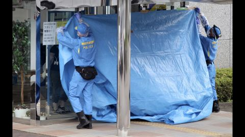 Investigators cover the entrance of the Tsukui Yamayuri-en center following the attack. Among the dead were nine men and 10 women, ranging in age from 18 to 70.