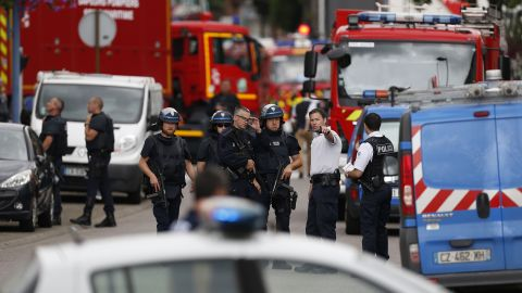 French police officers and firemen arrive at the scene of a hostage-taking at a church in Saint-Etienne-du-Rouvray, northern France, on Tuesday, July 26, which left a priest dead. Men armed with knives seized hostages at the church near the city of Rouen, a police source said. Police said they killed two hostage-takers in the attack in the Normandy town of Saint-Etienne-du-Rouvray, 125 kilometres (77 miles) north of Paris.
