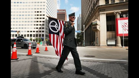 """Lou Pumphrey, who is with the nonprofit Veterans for Peace, walks through downtown Cleveland on Sunday, July 17, ahead of the <a href=""""http://www.cnn.com/2016/07/20/politics/gallery/outside-rnc-van-agtmael/index.html"""" target=""""_blank"""">Republican National Convention.</a>"""