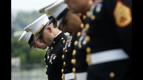 """U.S. Marines bow their heads during a memorial service in Chattanooga, Tennessee, on Saturday, July 16. The service marked one year since <a href=""""http://www.cnn.com/2015/07/20/us/tennessee-naval-reserve-shooting/"""" target=""""_blank"""">four Marines and a sailor were killed by a lone gunman</a> who shot up a military recruiting center and a local Navy operations support center."""