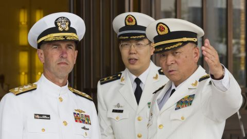 Wu Shengli, commander of the Chinese Navy, points out the layout of the Chinese Navy headquarters as he welcomes Adm. John Richardson, the chief of U.S. naval operations, to Beijing on Monday, July 18.