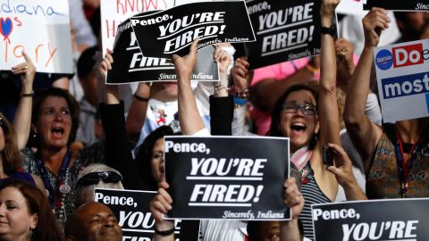 Delegates hold up signs referring to Indiana Gov. Mike Pence, the running mate of Republican nominee Donald Trump.