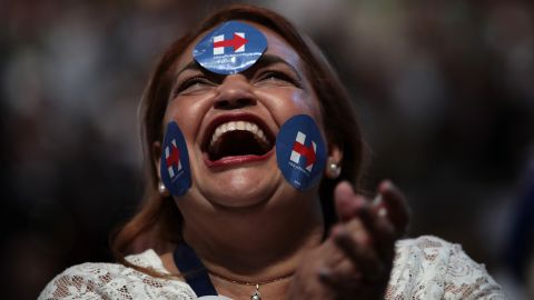 A delegate wears stickers in support of Clinton.