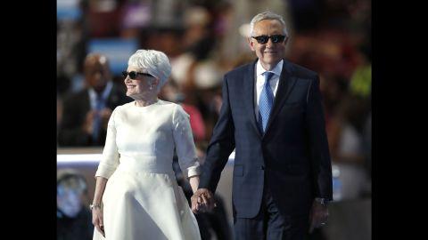 Senate Minority Leader Harry Reid is escorted to the podium by his wife, Landra, on Wednesday.