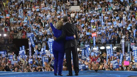 Obama and Clinton acknowledge the crowd.