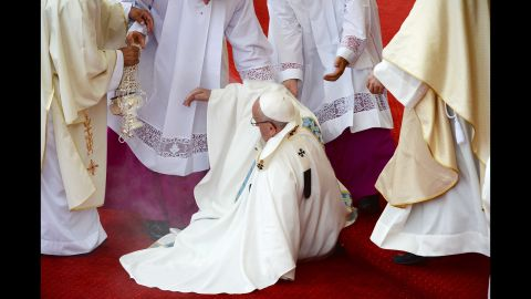 Pope Francis takes a fall during Mass in Czestochowa, Poland.