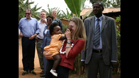 A baby pinches Chelsea's nose as she and her father visit a rural health-care clinic in Rwanda in August 2008. The former President was visiting Clinton Foundation projects in four African countries.