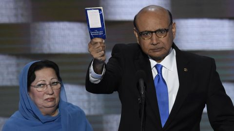 """Khizr Khan holds his personal copy of the U.S. Constitution as he speaks Thursday. His son, Humayun S. M. Khan, was one of the 14 American Muslims who have died serving their country since 9/11. In his remarks, Khan criticized the Republican nominee: """"If it was up to Donald Trump, (my son) never would have been in America. ... Donald Trump, you are asking Americans to trust you with our future. Let me ask you: Have you even read the U.S. Constitution? I will gladly lend you my copy."""""""
