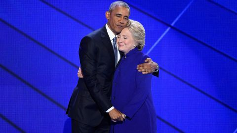 """Obama hugs Clinton after he gave a speech at the Democratic National Convention in Philadelphia. The president said Clinton was ready to be commander in chief. """"For four years, I had a front-row seat to her intelligence, her judgment and her discipline,"""" he said, referring to her stint as his secretary of state."""