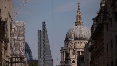 """Today, London's skyline juxtaposes the old and the new. Here the Leadenhall Building -- known as the """"Cheesegrater"""" -- leans sideways to avoid blocking St Paul's Cathedral."""