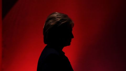 US Democratic presidential candidate Hillary Clinton leaves the stage during a break as she participates in the MSNBC Democratic Candidates Debate with Bernie Sanders at the University of New Hampshire in Durham on February 4, 2016.