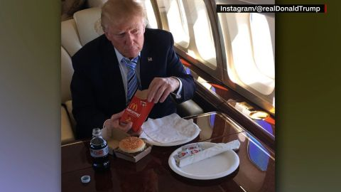 Trump takes a licking for eating finger lickin' chicken with a fork. CNN's Jeanne Moos reports.      KFC Knife and Fork   How do you eat your KFC chicken? Well we now know Donald Trump eats his with a knife and fork. At least there's a knife and fork in the photo the Donald tweeted of himself getting ready to chow down on his private plane with a bucket of KFC next to him and a piece on his plate. Will combine this with Jon Stewart's rant when Trump ate pizza with a knife and fork. And we'll toss in characters on Seinfeld eating Snickers bars with cutlery. We recreated the Trump KFC tableau using our own bucket of KFC. Also did MOS asking folks how they eat their KFC, hands or knife and fork. The hands have it hands down.