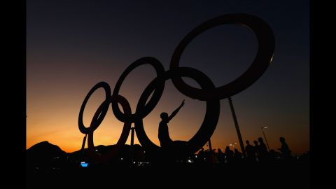 RIO DE JANEIRO, BRAZIL - AUGUST 01:  The sun sets over the Olympic Rings on the Olympic Park on August 1, 2016 in Rio de Janeiro, Brazil.  (Photo by Clive Rose/Getty Images)
