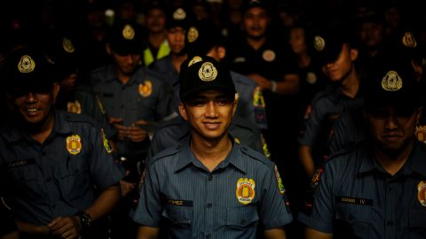 """Police officers stand in formation before the start of """"Oplan Rody"""" on June 1, 2016, a law enforcement operation named after President Duterte, whose nickname is Rody."""