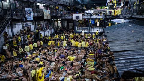 Inmates sleep on the ground of an open basketball court inside the Quezon City jail at night in Manila in this picture taken on July 21, 2016. There are 3,800 inmates at the jail, which was built six decades ago to house 800, and they engage in a relentless contest for space. Men take turns to sleep on the cracked cement floor of an open-air basketball court, the steps of staircases, underneath beds and hammocks made out of old blankets.  / AFP / NOEL CELIS / TO GO WITH AFP STORY: Philippines-politics-crime-jails, FOCUS by Ayee Macaraig        (Photo credit should read NOEL CELIS/AFP/Getty Images)