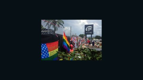 Mementos, flags, flowers and messages adorn a fence in front of Pulse nightclub south of downtown Orlando on Tuesday, July 19, 2016, more than a month after the deadly attack there.