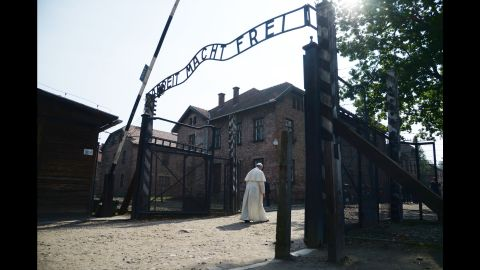 """Pope Francis passes the main entrance to Auschwitz-Birkenau, the former concentration camp in Poland, on Friday, July 29, 2016. The Pope <a href=""""http://www.cnn.com/2016/07/29/europe/poland-pope-auschwitz-visit/"""" target=""""_blank"""">was there to pay tribute</a> to those who died in the Holocaust."""