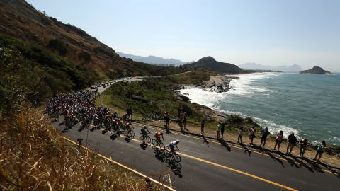 The peleton passes through Grumari during the men's road race in cycling. The race began at Fort Copacabana.