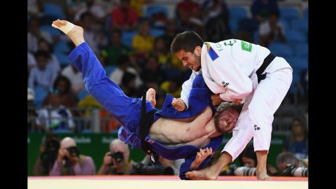 Tobias Englmaier of Germany, left, competes against Francisco Garrigos of Spain in the men's 60kg judo.