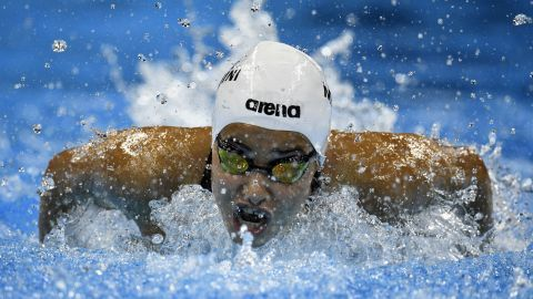 """Yusra Mardini, representing the <a href=""""http://www.cnn.com/2016/08/06/sport/rio-2016-refugee-team-olympics-syria/index.html"""" target=""""_blank"""">Refugee Olympic Team</a>, takes part in the women's 100-meter butterfly heat during the swimming event."""