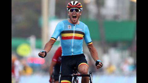 Greg Van Avermaet of Belgium celebrates winning the gold medal after crossing the finishing line the men's road race.