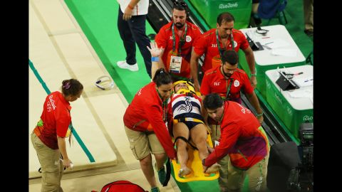 """Samir Ait Said of France receives medical attention <a href=""""http://www.cnn.com/2016/08/06/sport/rio-olympics-french-gymnast-breaks-leg/index.html"""" target=""""_blank"""">after breaking his leg on the vault</a> during the artistic gymnastics team qualification round on Saturday, August 6."""