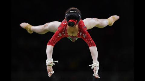 Jiaxin Tan of China competes on the uneven bars during the women's qualification for Artistic Gymnastics.