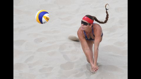 Brooke Sweat of the United States dives for the ball during the women's beach volleyball preliminary round.