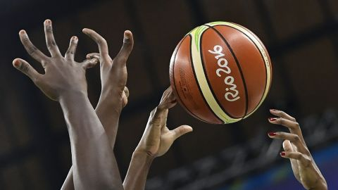 """Players reach out to the ball during the women's basketball match between USA and Senegal. The Americans won 121-56, <a href=""""http://edition.cnn.com/2016/08/02/sport/team-usa-womens-basketball-rio-2016/index.html"""" target=""""_blank"""">setting a new record </a>for the most points scored in Olympic history."""