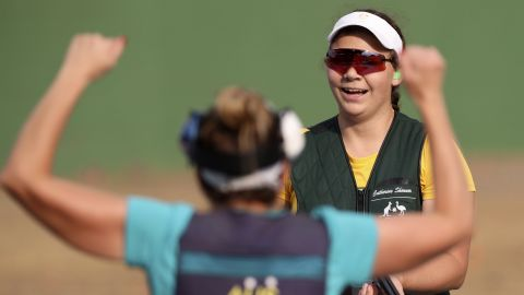 Catherine Skinner, right, celebrates her gold medal victory with fellow Australian Laetisha Scanlan, left, during the women's trap final at the Olympic Shooting Center.