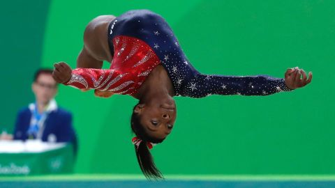 American gymnast Simone Biles leads the field in the women's individual all-around competition at the end of the second day of the Olympics.