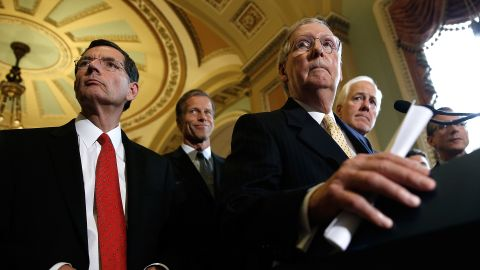 Senate Majority Leader Mitch McConnell answers questions with Republican leaders following the weekly Republican policy luncheon at the US Capitol on September 16, 2014 in Washington.