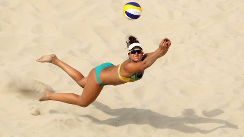 Australia's Mariafe Artacho del Solar dives during a beach volleyball preliminary match.
