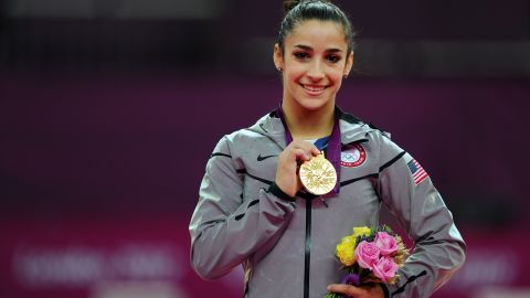 LONDON, ENGLAND - AUGUST 07:  Gold medalist Alexandra Raisman of the United States poses on the podium during the medal ceremony for the Artistic Gymnastics Women's Floor Exercise final on Day 11 of the London 2012 Olympic Games at North Greenwich Arena on August 7, 2012 in London, England.  (Photo by Michael Regan/Getty Images)