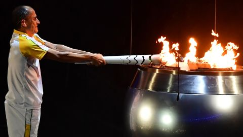 TOPSHOT - Former Brazilian athlete Vanderlei Cordeiro de Lima lights the Olympic cauldron with the Olympic torch during the opening ceremony of the Rio 2016 Olympic Games at Maracana Stadium in Rio de Janeiro on August 5, 2016. / AFP / Emmanuel DUNAND        (Photo credit should read EMMANUEL DUNAND/AFP/Getty Images)