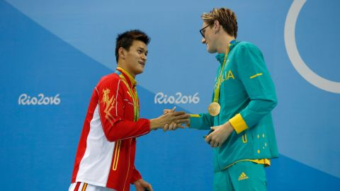 """Silver medalist Yang Sun of China and gold medalist Mack Horton of Australia shake hands after the 400-meter swimming freestyle on Saturday, August 6. The Australian had <a href=""""http://edition.cnn.com/2016/08/06/sport/horton-yang-swimming-rio-olympics-day-one/"""" target=""""_blank"""">opened up a war of words</a> against his Chinese opponent in the buildup to the final, saying: """"I don't have time or respect for drug cheats."""""""