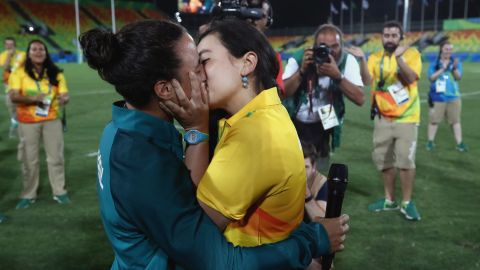 """Rugby player Isadora Cerullo of Brazil, left, kisses Marjorie Enya, a volunteer at the Games, on Monday, August 8. <a href=""""http://edition.cnn.com/2016/08/09/sport/marriage-proposal-olympics-brazil/"""" target=""""_blank"""">Enya proposed to Cerullo</a> after the rugby sevens match between Australia and New Zealand."""