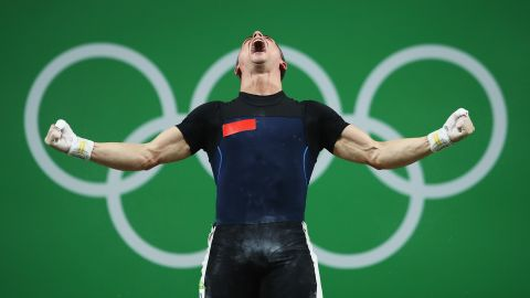Moldovan weightlifter Serghei Cechir celebrates after finishing in first place in the 69-kilogram (152-pound) weight class. He lifted 144 kilograms (317.5 pounds) in the snatch and 178 kilograms (392.4 pounds) in the clean and jerk for a combined 322 kilograms (709.9 pounds).