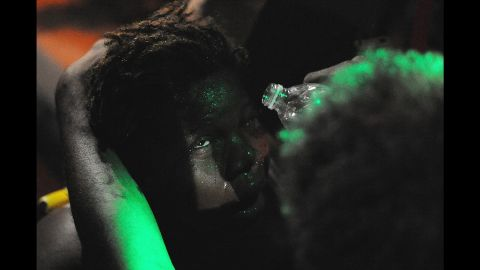 Scenes from Ferguson would at times show protesters treating their faces for exposure to elements like tear gas. This woman received assistance flushing out her eyes after being sprayed with mace when a peaceful protest escalated in August 2014.