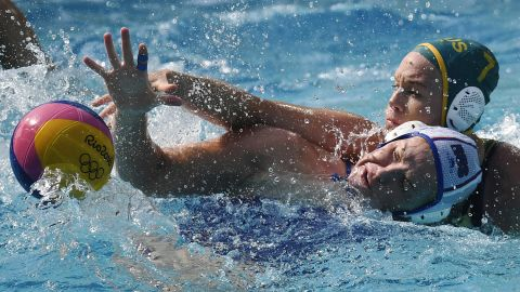 Australia's Rowie Webster, right, mugs Russia's Anna Timofeeva during a water polo match.