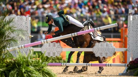 Brazilian rider Ruy Fonseca, on Tom Bombadill Too, hits an obstacle during the jumping round of the team eventing final.