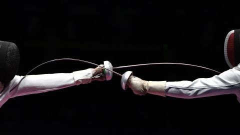 Hungarian fencer Geza Imre, left, competes against France's Gauthier Grumier during an epee semifinal. Imre won 15-13 to advance to the final, which he lost to South Korea's  <br />Park Sang-young.