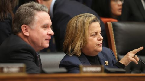 House Foreign Affairs Committee members Rep. Chris Smith (R-NJ) (L) and Rep. Ileana Ros-Lehtinen (R-FL) talk before a hearing about Cuba policy in the Rayburn House Office Building on Capitol Hill February 4, 2015 in Washington, DC.