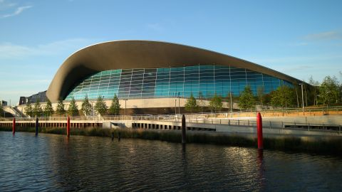 The Aquatics Center, designed by award-winning architect Zaha Hadid, now hosts other sporting events and offers subsidized entrance to local visitors.