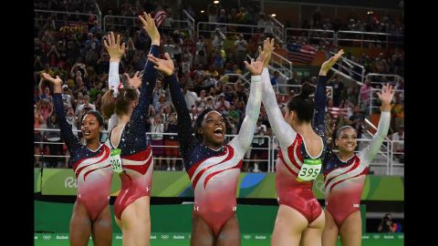 """U.S. gymnasts -- from left, Gabby Douglas, Madison Kocian, Simone Biles, Aly Raisman and Laurie Hernandez -- celebrate after <a href=""""http://www.cnn.com/2016/08/09/sport/womens-gymnastics-usa-team-simone-biles-rio-2016-olympics/index.html"""" target=""""_blank"""">winning the team all-around.</a> The United States also won gold in 2012."""