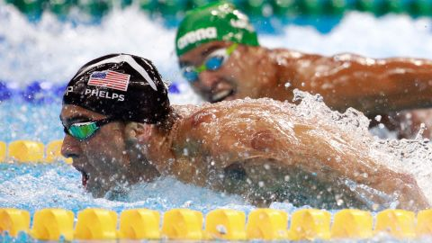 """South Africa's Chad Le Clos, right, looks over at U.S. swimmer Michael Phelps during <a href=""""http://www.cnn.com/2016/08/09/sport/michael-phelps-katie-ledecky-swimming/index.html"""" target=""""_blank"""">the 200-meter butterfly final</a> on Tuesday, August 9. Ahead of their semifinal, <a href=""""http://edition.cnn.com/2016/08/09/sport/phelps-face-olympics/index.html"""" target=""""_blank"""">the two were seen on camera</a> as Le Clos shadowboxed while Phelps just watched."""