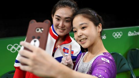 """South Korean gymnast Lee Eun-ju <a href=""""http://www.cnn.com/2016/08/08/sport/korea-gymnast-selfie/index.html"""" target=""""_blank"""">takes a selfie</a> with North Korean gymnast Hong Un-jong during training on Thursday, August 4. Relations have been frosty between the North and South since its division following the end of World War II, but geopolitics were put to the side as the two Olympians came together."""