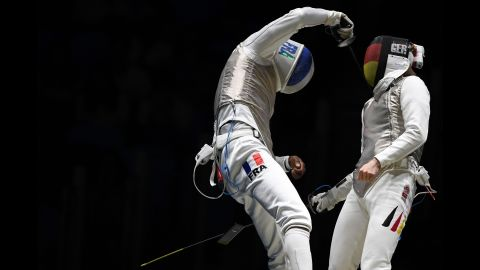 """A cell phone <a href=""""http://www.cnn.com/2016/08/09/sport/french-fencer-drops-phone/"""" target=""""_blank"""">falls out of the pocket of French fencer Enzo Lefort</a> as he competes against Germany's Peter Joppich on Sunday, August 7."""