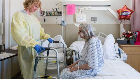 Nurse specialist Annelie Nilsson checks on Janet Prochazka.